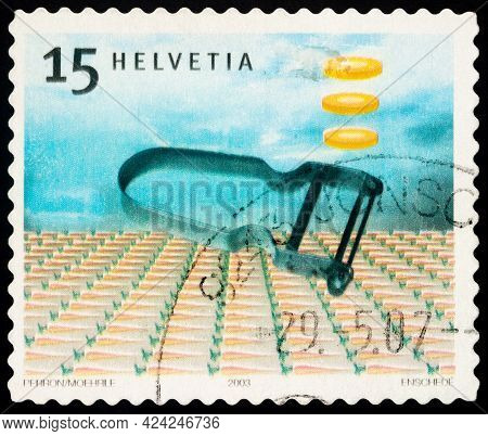 Moscow, Russia - June 20, 2021: Stamp Printed In Switzerland Shows Potato Peeler Rex (1947) Inventio