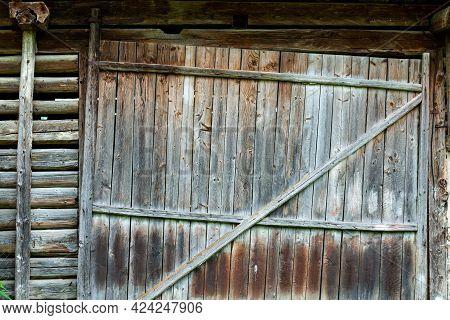 Old Traditional Pine Wood Barn Door On Abandoned Barn In Transylvania, Romania.