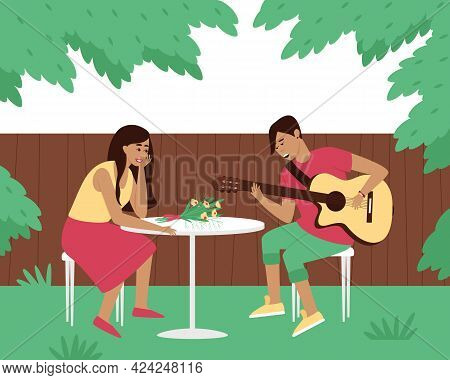 The Guitarist Plays A Serenade In The Yard Of His Woman. A Man Sings A Song With A Guitar. Date Of L