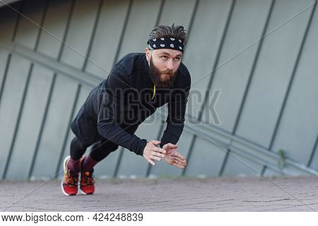 Sports Man Doing Push Ups With Claps During Outdoors Training.