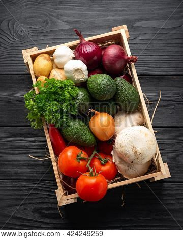 Fresh Vegetables In Wooden Box On Dark Wooden Background