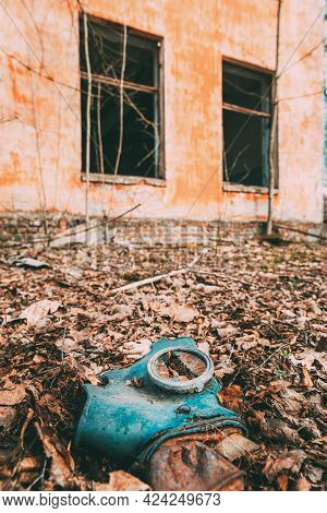 Gasmask Near Abandoned Ruined Old Village School Building In Chernobyl Resettlement Zone. Belarus. C