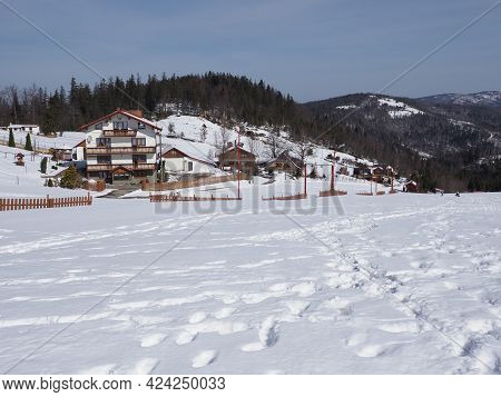 Snowy Silesian Beskid Mountains Range On European Bialy Krzyz In Poland With Clear Blue Sky In 2021