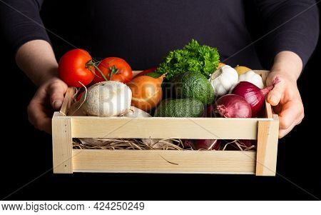 Woman Holding Wooden Box Full Of Fresh Raw Vegetables. Healthy Food.