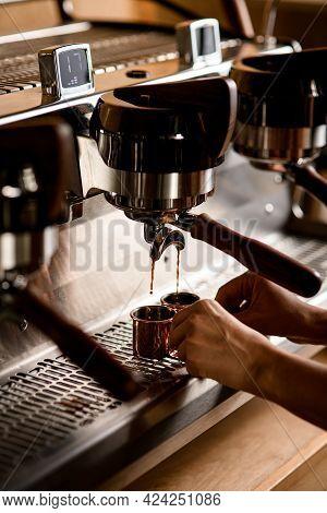 Professional Coffee Machine Pouring Espresso. Barista Preparing Deliciouse Fresh Hot Coffee