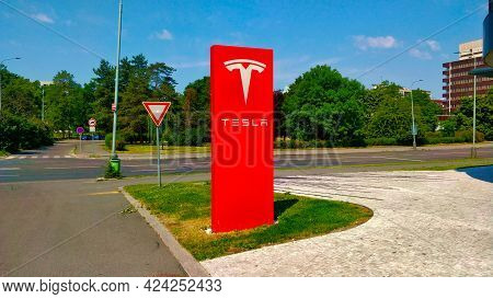 Prague, Czech Republic - June 19, 2021: Big Red Column With Tesla Sign For Marking A Car Dealer Sell