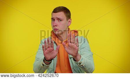 Hey You, Be Careful. Teenager Boy In Denim Jacket Warning With Admonishing Finger Gesture, Saying No