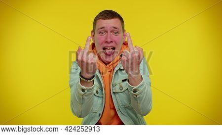 Aggressive Crazy Hooligan Stylish Teen Boy Showing Around His Middle Fingers, Demonstrating Protest