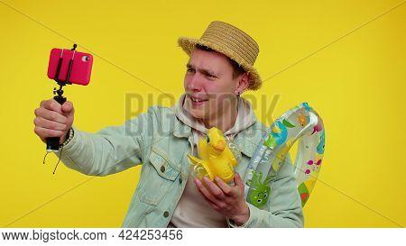 Handsome Stylish Teenager Boy Traveler Blogger In Sunglasses, Taking Selfie On Mobile Phone, Communi