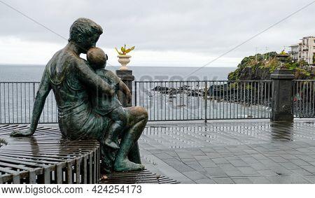 Piazza Castello, Aci Castello Comune, Sicily. This Statue, Named Madre E Figlio, Was Made By Sculptu
