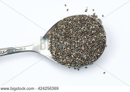 Raw Chia Seeds In A Spoon On A White Background. Chia Seeds Top View. Superfood From Seeds