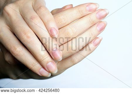 Girls Hands With Long Nails Without Nail Polish. Natural Female Hands On A White Background Top View