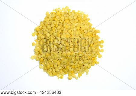 Yellow Lentils On A White Background. Raw Yellow Lentil Grains Top View.
