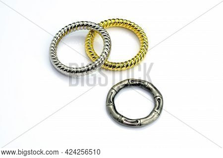 Decorative Rings Connecting With Braiding. Metal Ring For Clothes On A White Background. Cast Ring F