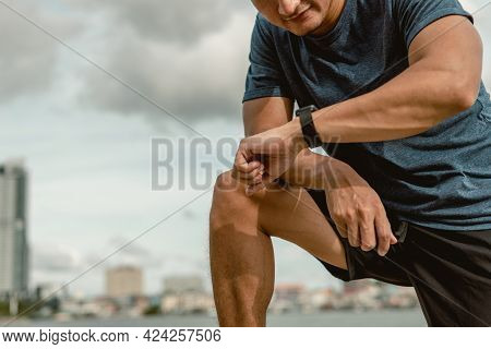 Sportsman Using Smart Watch To Monitor Performance. Man Is Setting Up His Smart Watch Before Exercis