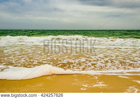 Sandy Beach. Nature Sea Sky Sand. Foam Of The Sea. Sea Texture. Summer Vacation Sea Concept.