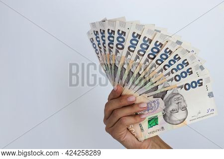 Ukrainian 500 Hryvnia. 500 Banknotes In A Hand On A White Background.