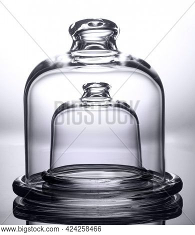Double Glass bell jar isolated on white, maximum protection mockup concept