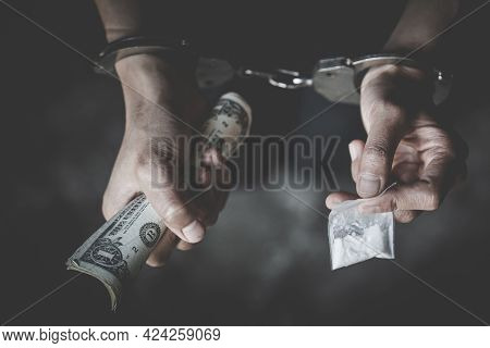 The Drug Dealer Was Arrested In Handcuffs, Drugs Money  In Concept About Danger And Threat Of The Dr