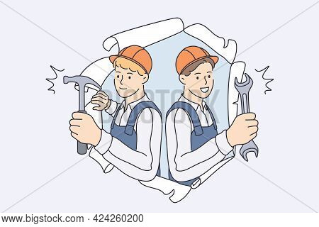 Repairmen During Construction Work Concept. Young Smiling Men Workers In Helmets And Working Uniform
