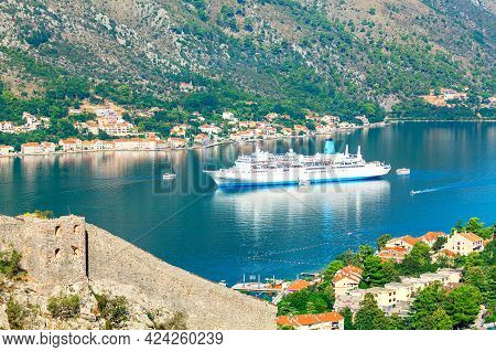 Cruise Ship In Kotor Bay Montenegro . Spectacular View Of Big Ship In Lagoon . Kotor Old Town . Cast