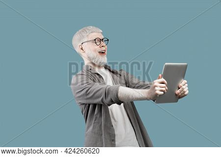 Online Offer. Shocked Albino Man Looking At Digital Tablet With Amazement, Standing With Open Mouth