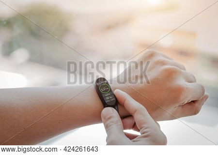Close Up White Smart Watch With Icon Heart Rate, Healthcare Concept.
