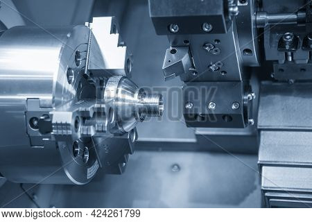 The  Cnc Lathe Machine Thread Cutting The Metal Cone Shape Parts. The Hi-technology Metal Working Pr