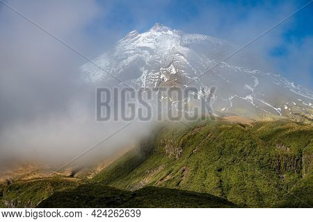 View Of The Summit Peak Of Mt.taranaki Covered With Winter Fog In Egmont National Park, New Zealand.