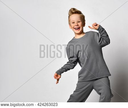 Little Boy Child With European Appearance Wearing Trendy Sportswear Fooling Around Loudly Laughing T