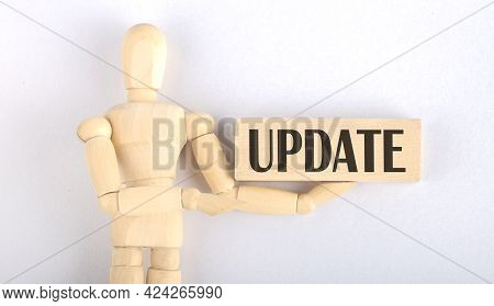 Wooden Man Shows With Hand To Block With Text Update