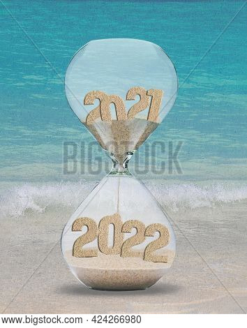New Year 2022 3d Illustration Hourglass Beach With Sand And Turquoise Ocean Water Background