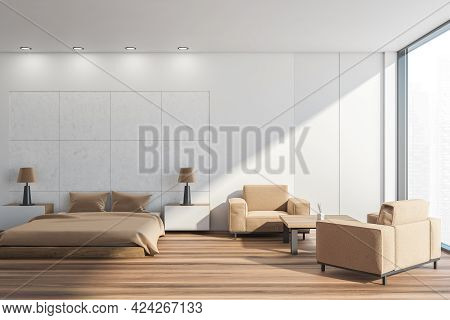 Light Bedroom Interior With Beige Bed And Pillows, Parquet Floor And Two Armchairs With Coffee Table