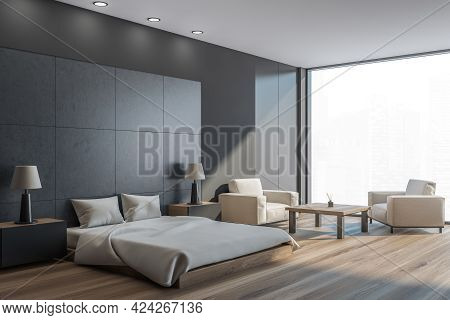 Dark Bedroom Interior With Grey Bed And Pillows, Side View, Parquet Floor And Two Armchairs With Cof