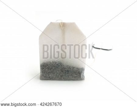 Front View Of Tea Bag On White Background. Close Up Of A Small Sealed Bag Of Porous Paper, Silk Or N