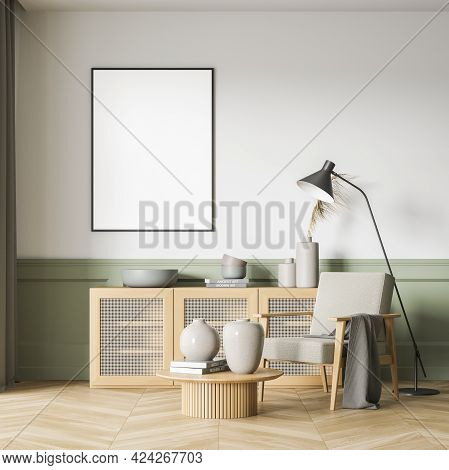 Green And White Art Room Interior With Grey Armchair And Wooden Commode, Books And Vase On Parquet F