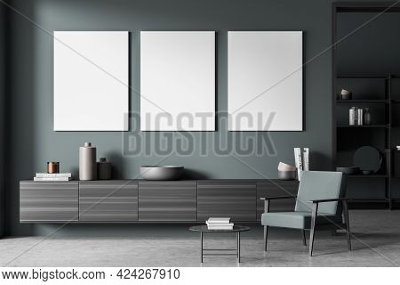 Blue Art Room Interior With Long Wooden Commode With Books And Vase, Armchair And Coffee Table On Co