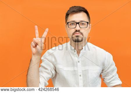 Young Handsome Man Wearing In White Shirt Over Isolated Yellow Background Showing And Pointing Up Wi
