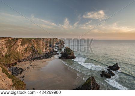 Stunning Landscape Image During Golden Hour On Cornwall Coastline At Bedruthan Steps