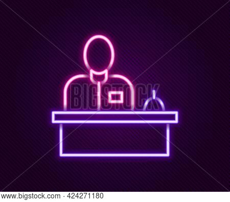 Glowing Neon Line Receptionist Standing At Hotel Reception Desk Icon Isolated On Black Background. C