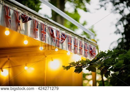 Shallow Depth Of Field (selective Focus) Details With The British Flag And A Merchandise Tent During