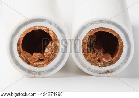 Old Broken Sludge Plumbing Polypropylene Pipes With Red Rust And Limescale. Corrosion, Sludge And Ha