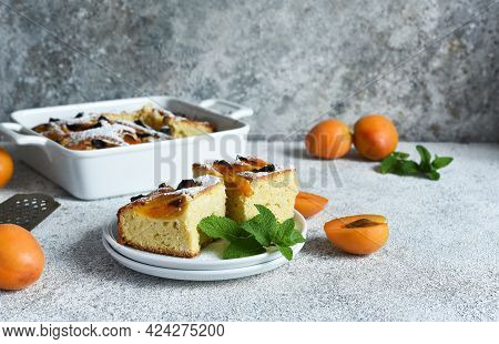 Cake With Apricots. Homemade Pie With Peaches And Apricots On The Kitchen Table.