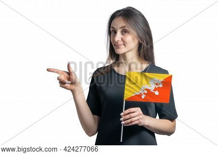 Happy Young White Woman Holding Flag Butane And Points To The Left Isolated On A White Background.