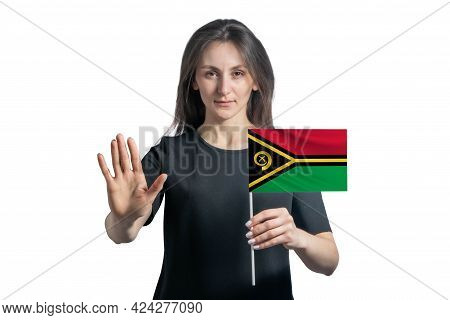 Happy Young White Woman Holding Flag Of Vanuatu And With A Serious Face Shows A Hand Stop Sign Isola