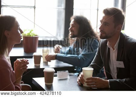 Interested Young Mixed Race People Attending Speed Dating.