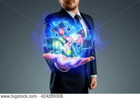 Creative Background, Online Casino Concept, Handsome Man Holding Neon Virtual Cards, Chipswith Roule