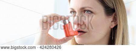 Sick Woman Holding Hormone Inhaler Near Mouth