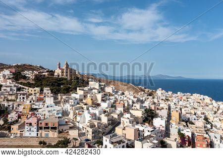 Syros Island, Greece, Aerial Drone View. Ermoupolis And Ano Siros Town Cityscape, Cloudy Blue Sky Ba
