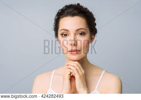 Young Beautiful Woman With Perfect Skin, Touching Her Face. Cosmetology, Beauty And Spa Concept.
